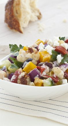 YUM --> Wow family and friends with the exotic flavors of this salad, which combines cauliflower, golden beets, cumin, chickpeas, cucumber, feta and Simply Dressed Greek Feta Salad Dressing. #EverydayMarzetti #spon