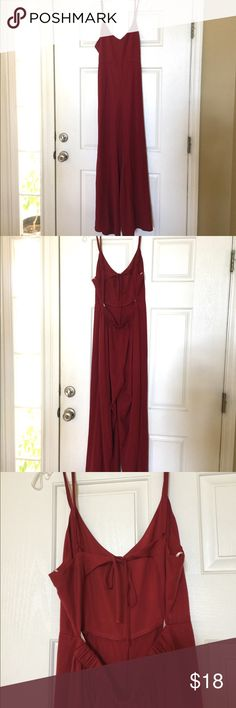"Beautiful Red open back wide leg jumpsuit Beautiful deep red wide leg open back jumpsuit. Elastic waist in the back with simple tie at the mid back. 30"" inseam. In new condition. Can easily be worn for a dressy event or just worn casually. Pictures dont do this jumpsuit justice. Forever 21 Pants Jumpsuits & Rompers"