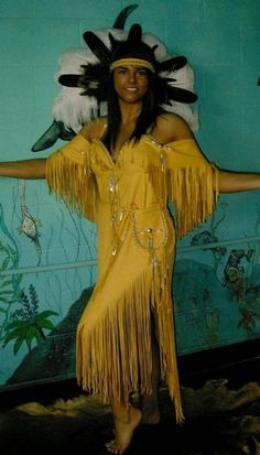 Deer hide dress with hip bag and lace up back. (head dress not included) http://nativeamericanstuff.net/Native%20American%20Style%20Crafted%20Clothing%20buckskins%20outfits%20moccasins%20and%20Handbags.htm