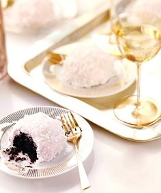 Chocolate coconut snowballs by Martha Stewart via Champagne & Macarons (http://champagnemacarons.blogspot.com/).