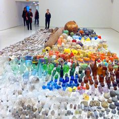 """2012 The Guggenheim Museum presents an installation by Mexican artist Gabriel Orozco titled """"Asterisms"""". The show features thousands of objects Orozco collected from the wildlife reserve Isla Arena in Mexico and the Pier 40 playing fields on Manhattan's west side - including glass bottles, lightbulbs, buoys, tools, stones, and oars."""