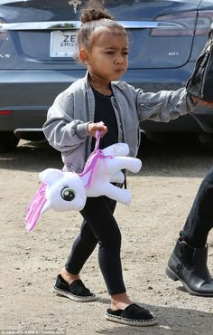 Her little pony: The youngster accessorised with her My Little Pony plush, the aptly named Sweetie Belle