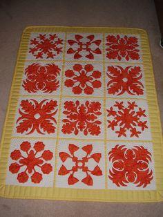 A sampler quilt wall hanging of Hawaii's favorite flowers. Great Hawaiian quilt patterns