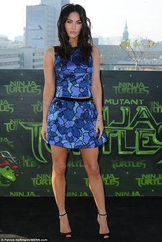 Smooth operator: Megan Fox sparked Botox questions when she stepped out with a wrinkle-free face at a photocall for her new movie Teenage Mutant Ninja Turtles in Berlin, Germany, on Sunday Megan Fox Legs, Megan Fox Face, Megan Denise Fox, Megan Fox Outfits, Megan Fox Bikini, Megan Fox Pictures, Girls In Mini Skirts, Sexy Legs And Heels, Blue Dresses