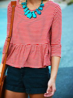 striped peplum with accent necklace and shorts. LOVE
