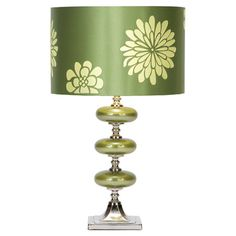 Metal table lamp with a drum shade and floral motif. Product: Table lamp Construction Material: Glass and fabric