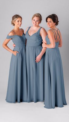 Mismatched bridesmaid dresses in slate blue. More