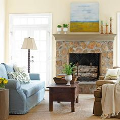 Contemporary Country  Country style leans casual but can be given a sophisticated vibe with a few contemporary elements. This stone fireplace is decidedly country, but the abstract artwork above the mantel lends a modern edge.