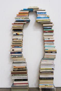 House Arrest 2 (2009) by Eva Kotátková.  [ #books #installation #sculpture #silhouette ]