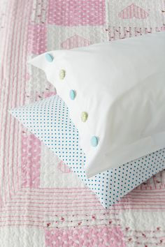 Pillow decorated with self-cover buttons