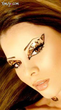 Cheetah Eyes Kit - Cheetah costume eyes kit includes cheetah print, glitter lid appliques, brown glitter, applique brush and extra long false eyelashes. Reusable and waterproof.