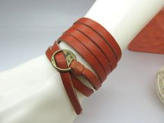 Simple and stylish leather jewelry  made of Orang leather cord and copper accessorise    LB98. $9.00, via Etsy.