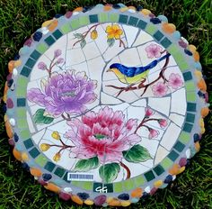 This beautiful colored MOSAIC STEPPING STONE/WALL DECOR will make a stunning focal point to your HOME OR GARDEN. This handcrafted STEPPING STONE features MOSAIC Pattern in BOLD VIVID COLORS. Made of cement and colored tile. Its good for INDOOR AND OUTDOOR magnificent decoration. IT