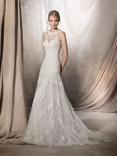 Hakan WEDDING DRESSES 2017 Bohemian and very romantic. This A-line wedding dress with a halter neck is made of lace and guipure. The tulle skirt adds volume to the piece.