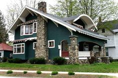 Beautiful 1904 Bungalow, Saratoga Springs dark green + round stone piers on craftsman style bungalow porch Cottage Exterior Colors, Craftsman Bungalow Exterior, Exterior Paint Colors For House, Craftsman Style Homes, Craftsman Bungalows, Paint Colors For Home, Paint Colours, Bungalow Porch, Home Plans