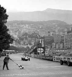 1960 Monaco Stirling Moss in a Lotus 18 crosses the finish line
