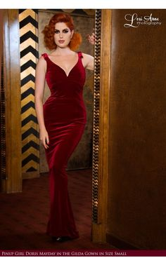 he Gilda Gown from Laura Byrnes will drape your body in allure and hug your curves the way they deserve. Made with a sumptuously soft and plush stretch Ruby Red velvet, this full-length gown features a curved, plunging v-neckline. Fully-lined with a lightweight knit fabric and constructed with a hidden internal bengaline shaper in the bust and waist to hold and shape your figure