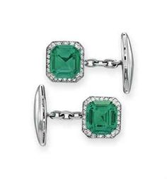 A PAIR OF EMERALD AND DIAMOND CUFFLINKS -   Each set with a modified rectangular-cut emerald, weighing approximately 4.44 and 3.28 carats, within an old European-cut diamond surround, joined by a chain to the platinum terminal, mounted in platinum