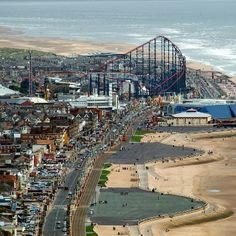 Showing Blackpool's seafront with Blackpool Pleasure Beach and Sandcastle