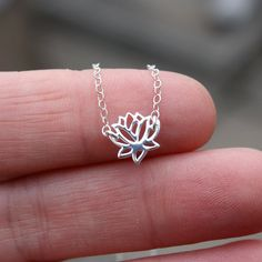 Hey, I found this really awesome Etsy listing at https://www.etsy.com/listing/90069645/tiny-lotus-flower-necklace-sterling
