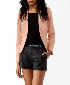 An essential textured woven blazer featuring a satin back and horizontal threading. Notched lapel. Single-button closure. Curved hem. Long sleeves with two buttons. Flapped front pockets. Padded shoulders. Shirred back yoke. Seam stitch details. Self-tie back. Partially lined. Light to medium weight.