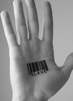 This signifies Annie's obedience   This photo is of a persons hand stamped with bar code and the word slave. The bar code described her character of not having any freedom.   Annie, has to be scanned by  everyone at the Circle making sure that She gives the right accommodations. The word  slave is what She  became  to her work.