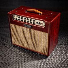 """""""LoneStar 1x12 Combo in a Flame Maple cab with Crimson Hand-rubbed Stain and Wicker Cane Grille.  With its 2 fully independent Channels and 100/50/10w…"""""""