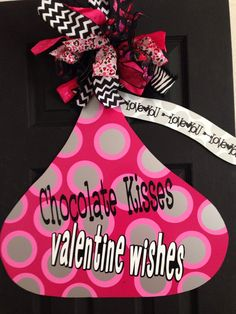 Kisses for everyone! This Valentines Day door hanger is cut out of metal, primed and painted bright hot pink with silver and pink polka