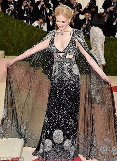 Out of this world: Nicole Kidman and Dakota Johnson's gowns were had a cosmic theme...