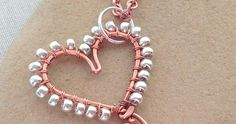 How to wire wrap beads on the outside of a wire frame to make a terrific heart pendant - free tutorial.