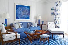 A geometric flat weave is more casual and youthful than a heavy Oriental or wool rug. Balance it out with a large piece of modern art framed in a simple white gallery frame. Finish with blue glass lamps or a pretty bowl to add sparkle and dimension.