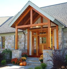 Open Beam Porch Ceiling | The timber frame entry porch features two accent timber frame trusses