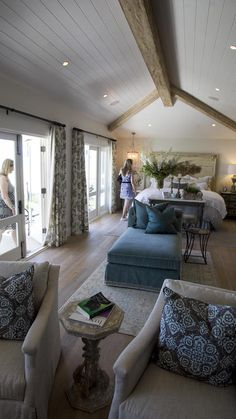 Guests take a look at the view from the master bedroom at the Buntmann Residence at 2054 East Oceanfront during the Newport Harbor Home tour on Thursday, May 15. (Scott Smeltzer - Daily Pilot)