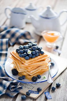 We're having lots of waffles this morning with fresh blueberries. Yum............