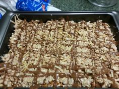 Dude food layer bars Peanut butter pretzel graham cracket crust Caramel White chocolate covered chips and peanuts Chocolate drizzle with chip garnish