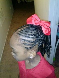 Braids into ponytail wit curls at the end