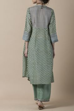 LAILA Handblock printed kurta in silk modal with a striped placket, and pattern of chevrons on the sleeve cuffs, teamed with a habutai silk farshi.