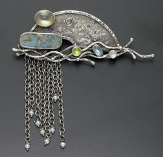 Waterfall Brooch by ThorntonMetals on Etsy, $750.00. This brooch is made of reticulated and fused silver with hammered wires and semiprecious stones. The pin stem is hand fabricated also.    Size: 2.78 inches x 3.25 inches    Stones used: pearl, boulder opal, moonstone, tourmaline   If you like please repin, like and/or leave a comment. Thanks  Source: ThorntonMetals on etsy.com  20130203 18:26