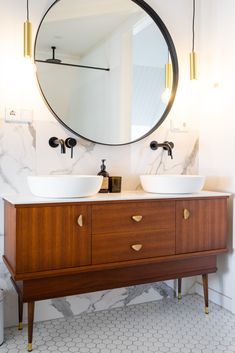 Vintage Bathroom Cabinet White Marble Bathroom With Black And Gold Accents This Vintage Mahogany Cabinet Was Repurposed As Bathroom Cabinet Vintage Bathroom Cabinet, Kitchen Marble, Mahogany Cabinets, Vintage Bathroom, Wood Floor Bathroom, White Marble Bathrooms, Round Mirror Bathroom, Bathroom, Wood Bathroom