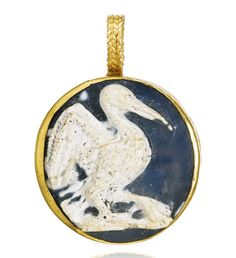 Byzantine, 12th century PENDANT SET WITH A CAMEO OF A PELICAN onyx, mounted in gold with a filigree loop 32mm., 1¼in. overall