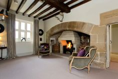 Quirky living space at Ackworth Old Hall with a fantastic pair of decorative antlers above the stone fireplace