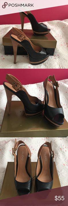 Aldo Leather Pumps Lightly used aldo leather pumps. Platform heel. Black and brown sling back with adjustable buckle. Aldo Shoes Heels