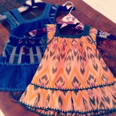 I got the cat in me little baby dresses