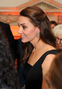 The Duchess looked radiant in the black cocktail dress by Preen, which she wore with a spa...