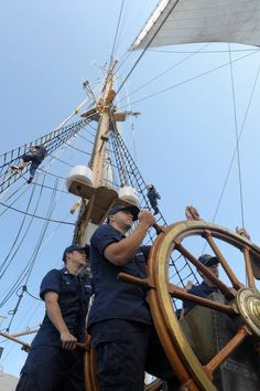 ATLANTIC OCEAN - Coast Guard Academy cadets man the helm of the Cutter Eagle while crewmen move through the rigging in preparation for the cutter to tack into the wind, May 30, 2012. The Eagle, the Coast Guard's sailing ship, is used as a training platform which stresses teamwork and leadership development amongst the trainees. U.S. Coast Guard photo by Petty Officer 3rd Class David Weydert. Petty Officer 3rd Class David Weydert #coastie #coastguard