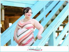 beach goddess, maternity shoot, on the beach, Fresh Look Photography, goddess, coral and teal, under the pier, evening glow, pregnancy photo shoot, baby boy, unique pregnancy announcement