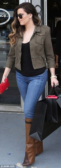 Khloe Kardashian love her hair here but her boots look weird lol