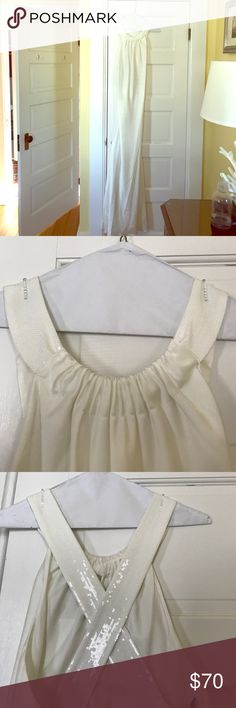 Stunning Ivory silk Calvin Klein Gown Full length lined silk gown with sequined straps and ruched neckline. Plunging back with cross straps. Perfect for a wedding, Prom, or military ball. Worn once. Calvin Klein Dresses Prom