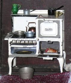 Antique miniature wood cooking stove by Arcade - perfect for an old Quebec farmhouse   Source: Jennifer McKendry