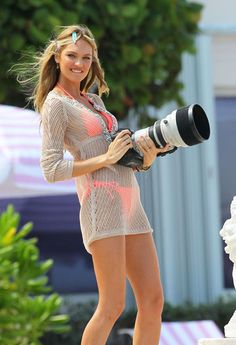 Erin Heatherton poses for a photoshoot and then goes for a swim in the ocean in Miami. During her photoshoot, she grabs the camera and becomes the photographer!
